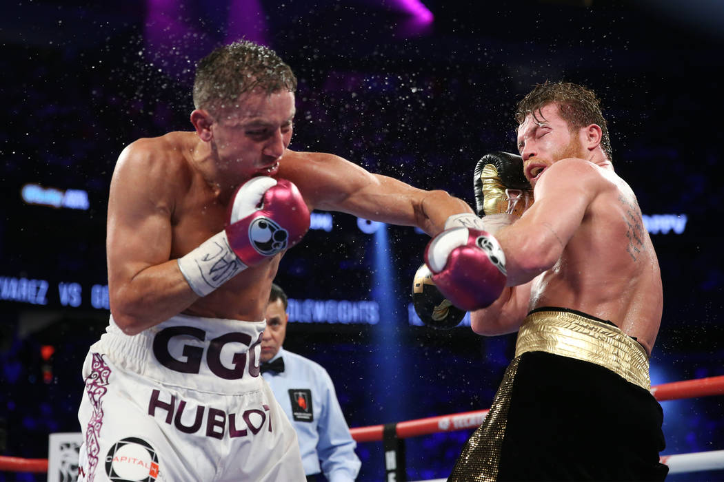 """Gennady Golovkin, left, connects a punch against Saul """"Canelo"""" Alvarez in the WBC, WBA, IBO, RING middleweight title bout at T-Mobile Arena in Las Vegas, Saturday, Sept. 15, 2018. Alvare ..."""
