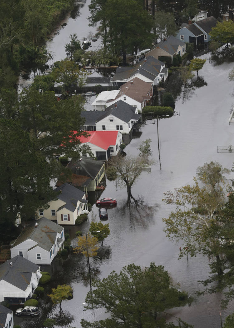 Flooded homes along the Neuse river in New Bern, NC., Saturday, Sept. 15, 2018. (AP Photo/Steve Helber)