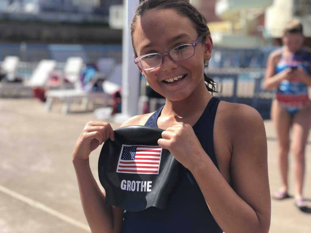 Jenny Freshour, 11, poses with Olympic prospect and national record holder Zane Grothe's swim cap during a swim clinic hosted by Grothe at the Henderson multigenerational pool on Saturday, Sept. 1 ...