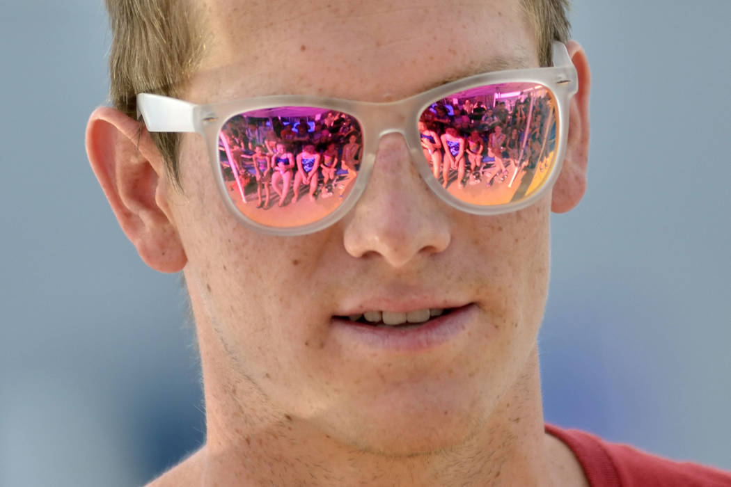 Young swimmers are reflected in the sunglasses of Zane Grothe while he conducts a swimming clinic for members of the Boulder City Henderson Swim Team at the Henderson Multigenerational Center at 2 ...