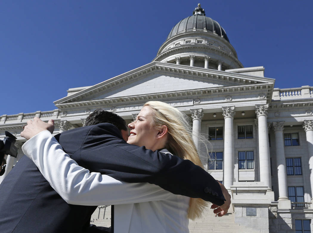 Elizabeth Smart receives a hug before speaking at a news conference Thursday, Sept. 13, 2018, in Salt Lake City. Smart says it appears there is no viable, legal recourse she can take to stop the r ...