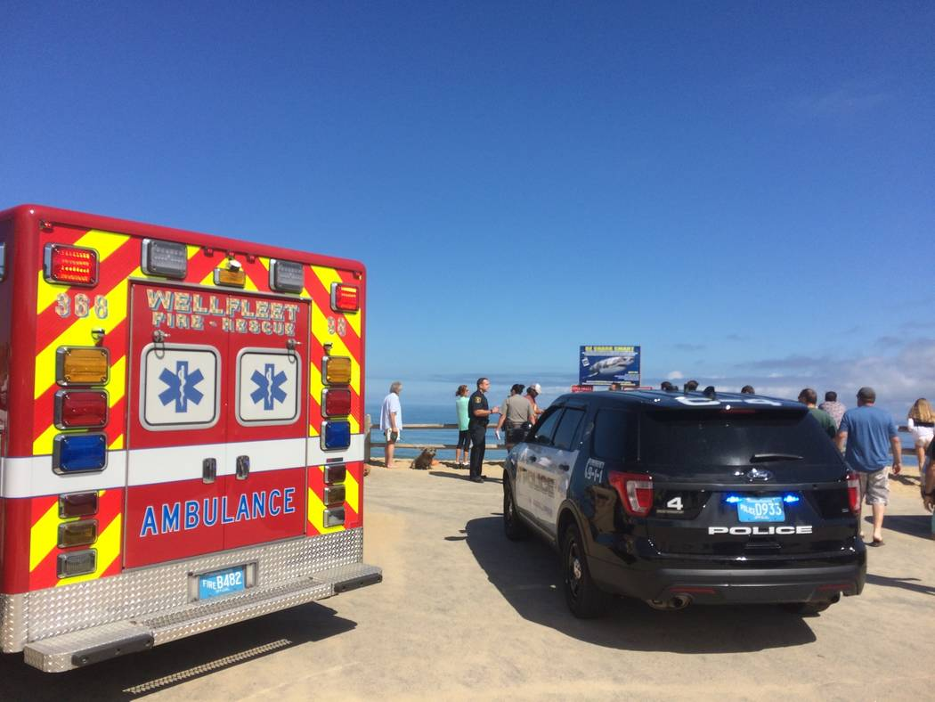 Emergency personnel respond to Newcomb Hollow Beach in Wellfleet, Mass, on Saturday, Sept. 15, 2018. The Cape Cod Times says rescue crews responded to Newcomb Hollow Beach in Wellfleet at aroun ...
