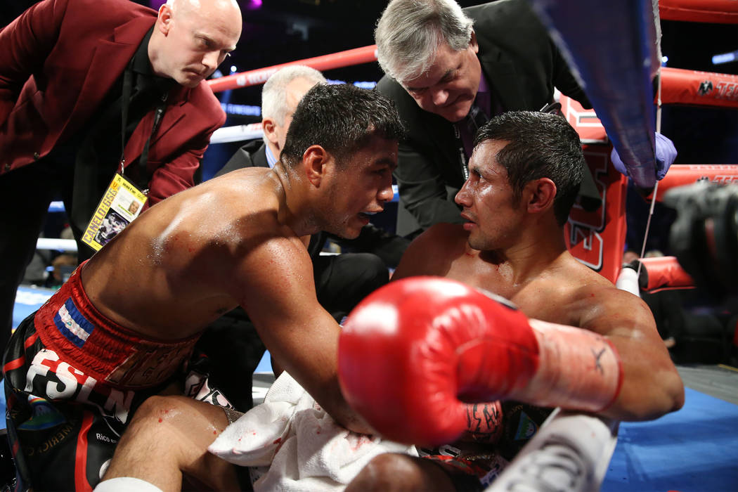 Roman Gonzalez, left, checks on his opponent Moises Fuentes after his fifth round knockout win in the bantamweight bout at T-Mobile Arena in Las Vegas, Saturday, Sept. 15, 2018. Erik Verduzco Las ...