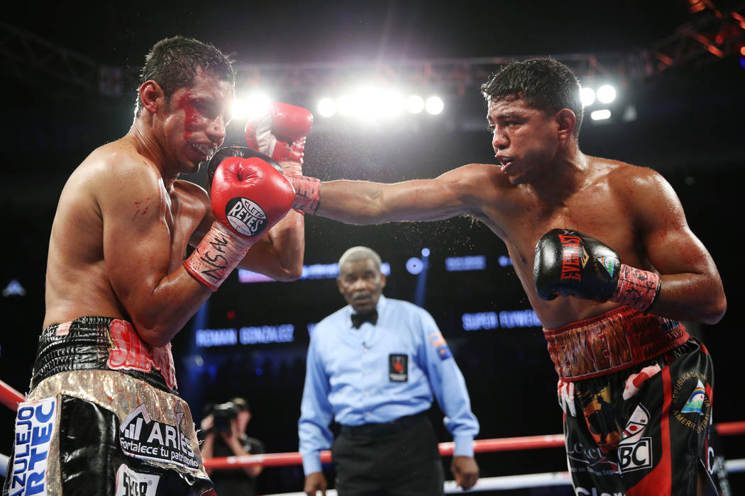 Roman Gonzalez, right, connects a punch against Moises Fuentes in the bantamweight bout at T-Mobile Arena in Las Vegas, Saturday, Sept. 15, 2018. Gonzalez won by way of knockout in the fifth round ...