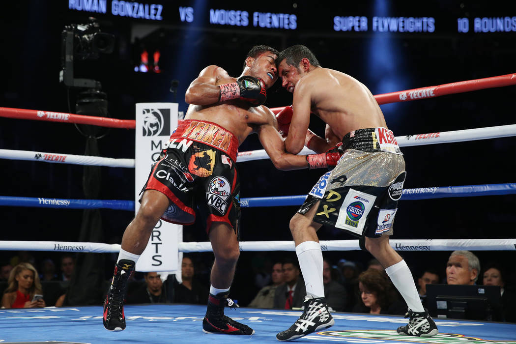 Roman Gonzalez, left, connects a punch against Moises in the bantamweight bout at T-Mobile Arena in Las Vegas, Saturday, Sept. 15, 2018. Gonzalez won by way of knockout in the fifth round. Erik Ve ...