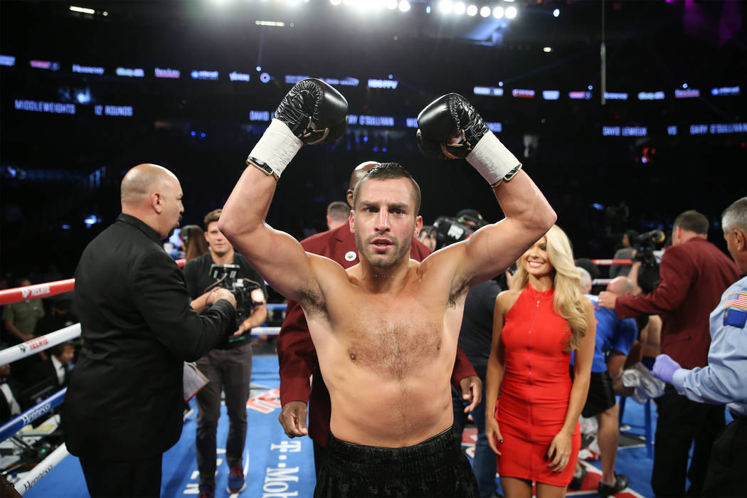 David Lemieux celebrates his win against Gary O'Sullivan by way of knockout in the first round of the WBA middleweight title eliminator bout at T-Mobile Arena in Las Vegas, Saturday, Sept. 15, 201 ...