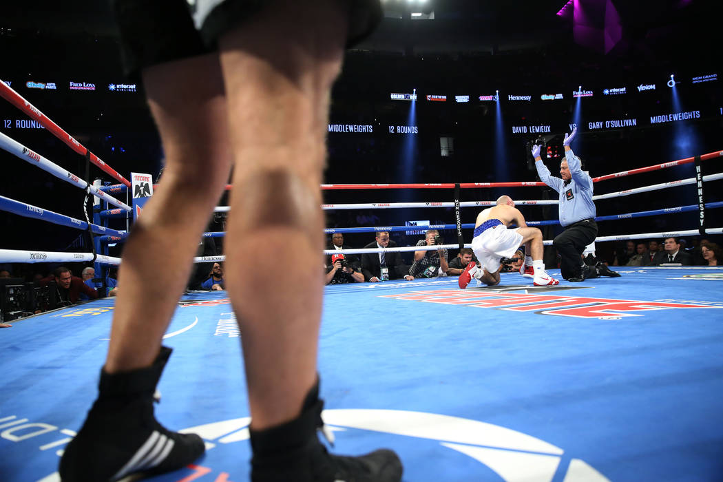David Lemieux, left, watches as the referee ends his bout against Gary O'Sullivan for a knockout win in the WBA middleweight title eliminator bout at T-Mobile Arena in Las Vegas, Saturday, Sept. 1 ...