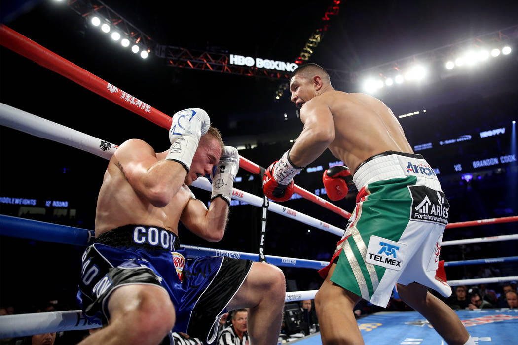 Brandon Cook, left, battles Jaime Munguia in the WBO middleweight title bout at T-Mobile Arena in Las Vegas, Saturday, Sept. 15, 2018. Munguia won by way of technical knockout in the third round. ...