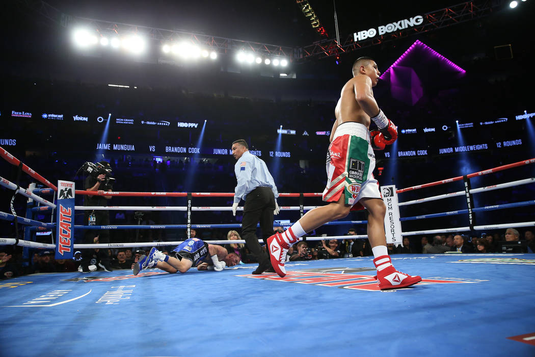 Jaime Munguia walks to his corner after knocking down Brandon Cook in the third round of the WBO middleweight title bout at T-Mobile Arena in Las Vegas, Saturday, Sept. 15, 2018. Munguia won by wa ...