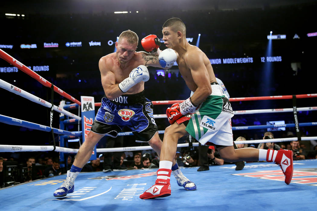 Jaime Munguia, right, gets ready to throws a punch against Brandon Cook in the WBO middleweight title bout at T-Mobile Arena in Las Vegas, Saturday, Sept. 15, 2018. Munguia won by way of technical ...