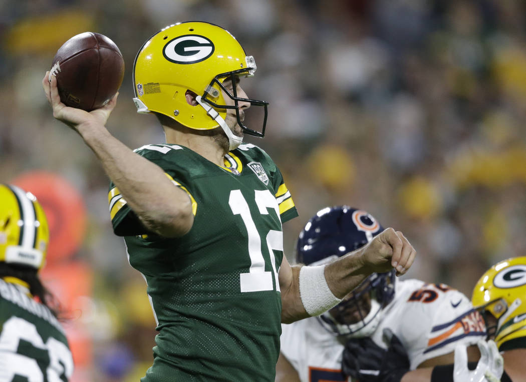 Green Bay Packers' Aaron Rodgers throws during the second half of an NFL football game -against the Chicago Bears Sunday, Sept. 9, 2018, in Green Bay, Wis. (AP Photo/Jeffrey Phelps)