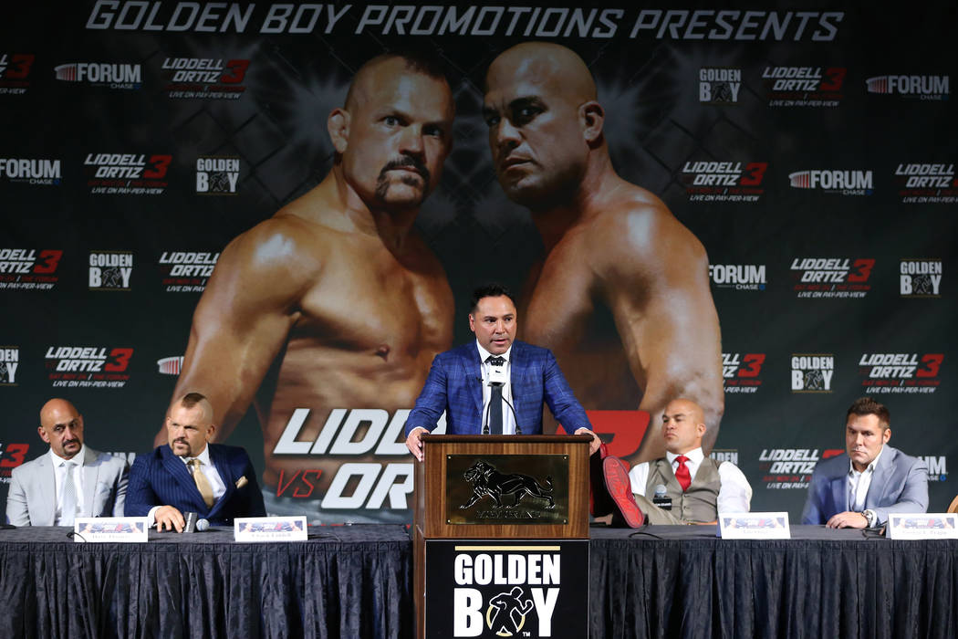 Sports promoter Oscar De La Hoya, center, speaks during a press conference with Chuck Liddell, second from left, and Tito Ortiz, second from right, at MGM Grand hotel-casino in Las Vegas, Friday, ...