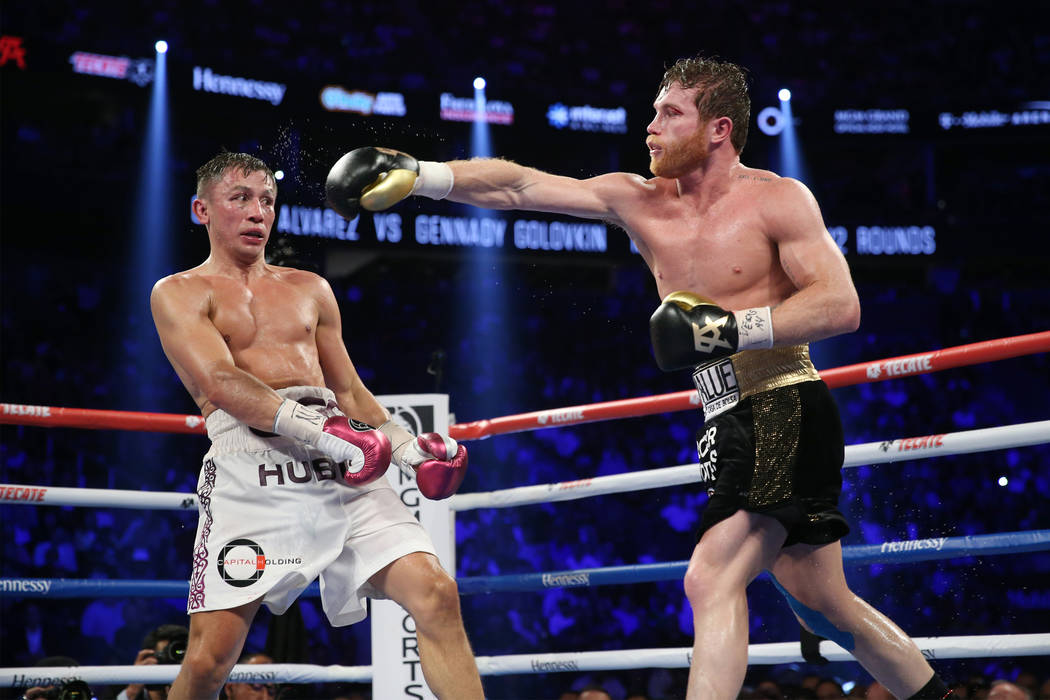 "Gennady Golovkin, left, battles Saul ""Canelo"" Alvarez in the WBC, WBA, IBO, RING middleweight title bout at T-Mobile Arena in Las Vegas, Saturday, Sept. 15, 2018.Alvarez won by maj ..."