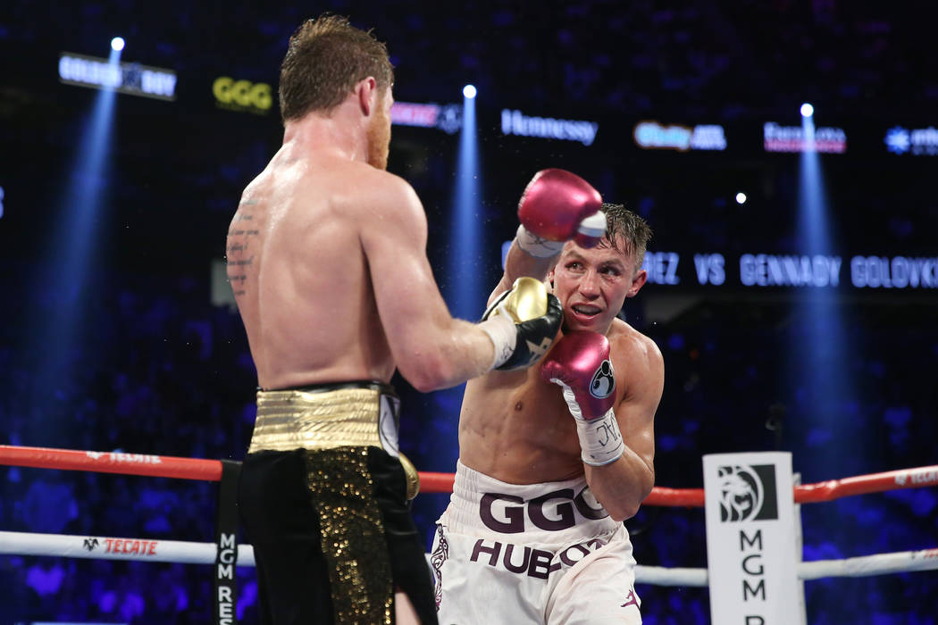 "Gennady Golovkin, right, throws a punch against Saul ""Canelo"" Alvarez in the WBC, WBA, IBO, RING middleweight title bout at T-Mobile Arena in Las Vegas, Saturday, Sept. 15, 2018. Al ..."