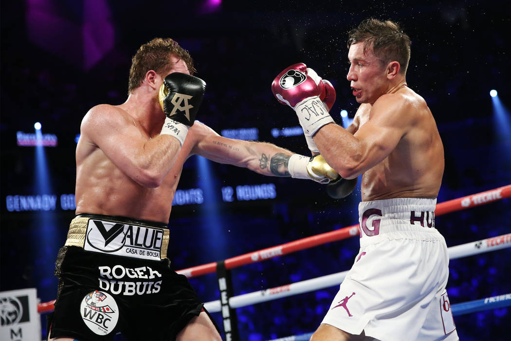 """Saul """"Canelo"""" Alvarez, left, throws a punch against Gennady Golovkin in the WBC, WBA, IBO, RING middleweight title bout at T-Mobile Arena in Las Vegas, Saturday, Sept. 15, 2018.Alv ..."""