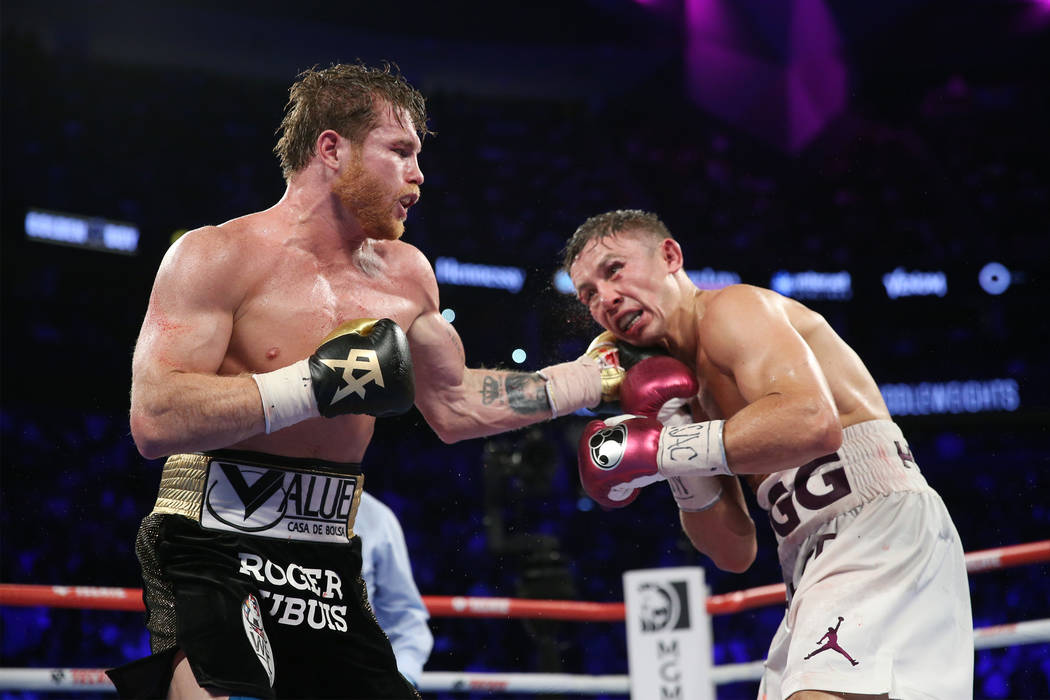 "Saul ""Canelo"" Alvarez, left, connects a punch against Gennady Golovkin, in the WBC, WBA, IBO, RING middleweight title bout at T-Mobile Arena in Las Vegas, Saturday, Sept. 15, 2018.  ..."