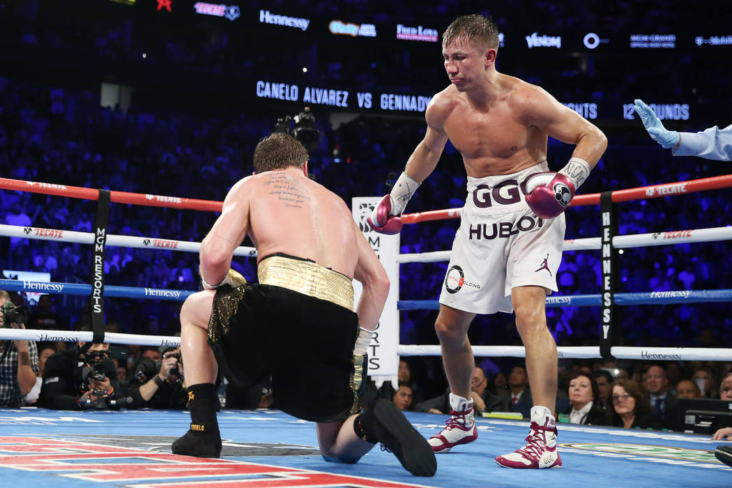 """Saul """"Canelo"""" Alvarez, left, slips against Gennady Golovkin, in the WBC, WBA, IBO, RING middleweight title bout at T-Mobile Arena in Las Vegas, Saturday, Sept. 15, 2018.Alvarez won ..."""