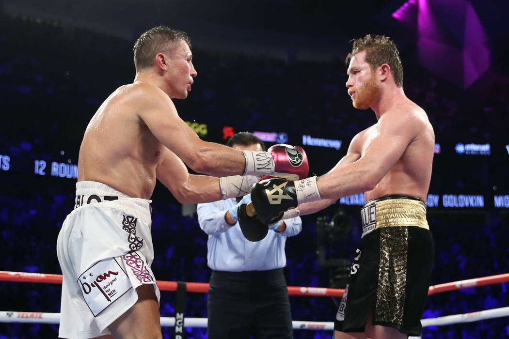 """Gennady Golovkin, left, and Saul """"Canelo"""" Alvarez, touch gloves at the begging of the 12th round in the WBC, WBA, IBO, RING middleweight title bout at T-Mobile Arena in Las Vegas, Saturd ..."""