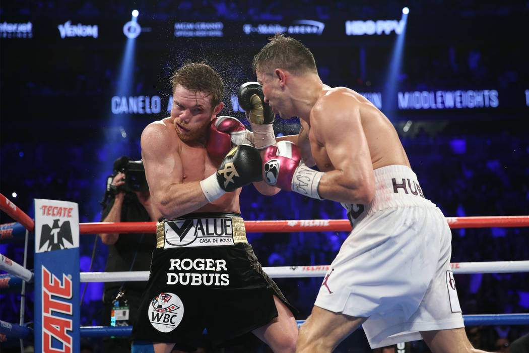 "Gennady Golovkin, right, connects a punch against Saul ""Canelo"" Alvarez in the WBC, WBA, IBO, RING middleweight title bout at T-Mobile Arena in Las Vegas, Saturday, Sept. 15, 2018.  ..."