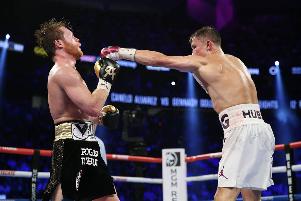 """Gennady Golovkin, right, connects a punch against Saul """"Canelo"""" Alvarez in the WBC, WBA, IBO, RING middleweight title bout at T-Mobile Arena in Las Vegas, Saturday, Sept. 15, 2018. ..."""