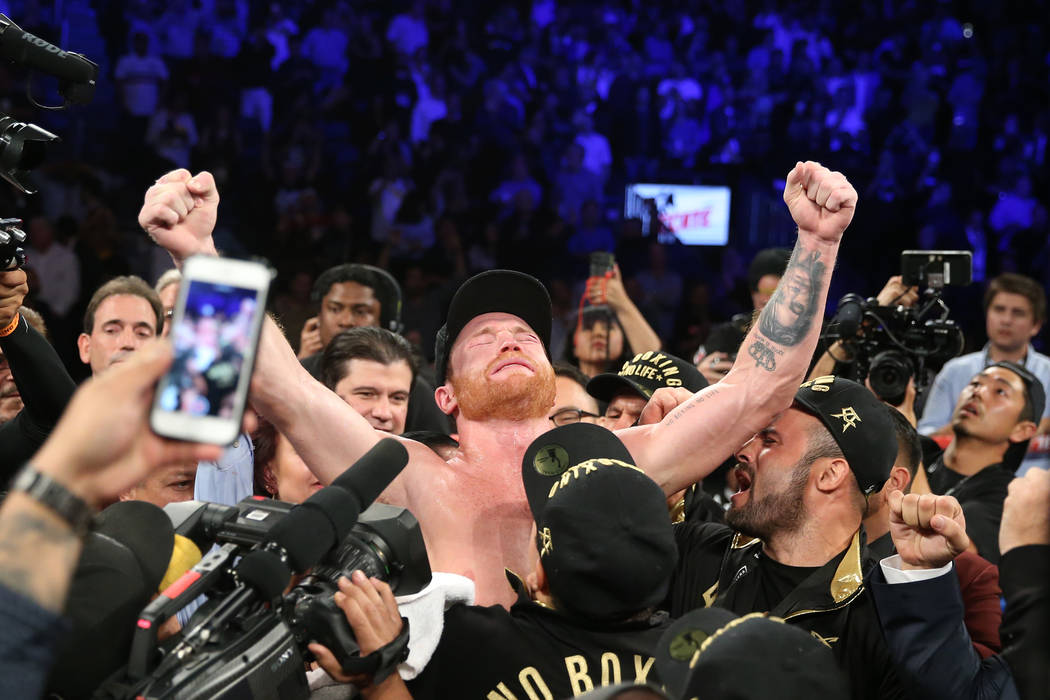 "Saul ""Canelo"" Alvarez, center, reacts to his majority decision win against Gennady Golovkin in the WBC, WBA, IBO, RING middleweight title bout at T-Mobile Arena in Las Vegas, Saturday, S ..."