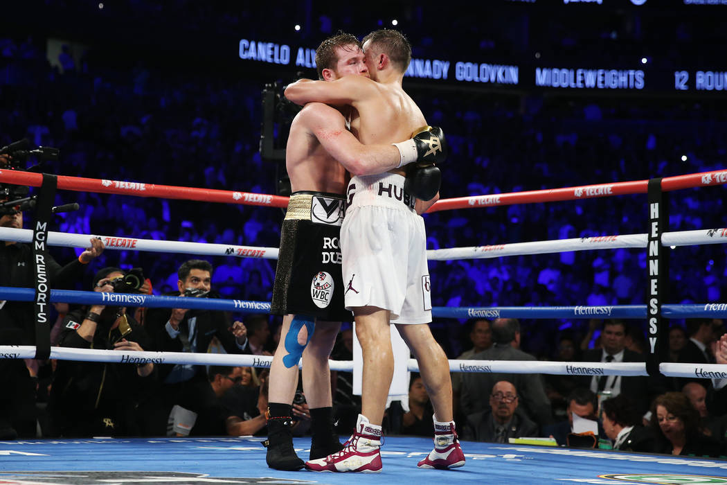 "Saul ""Canelo"" Alvarez, left, and Gennady Golovkin, embrace following their WBC, WBA, IBO, RING middleweight title bout at T-Mobile Arena in Las Vegas, Saturday, Sept. 15, 2018. Alva ..."