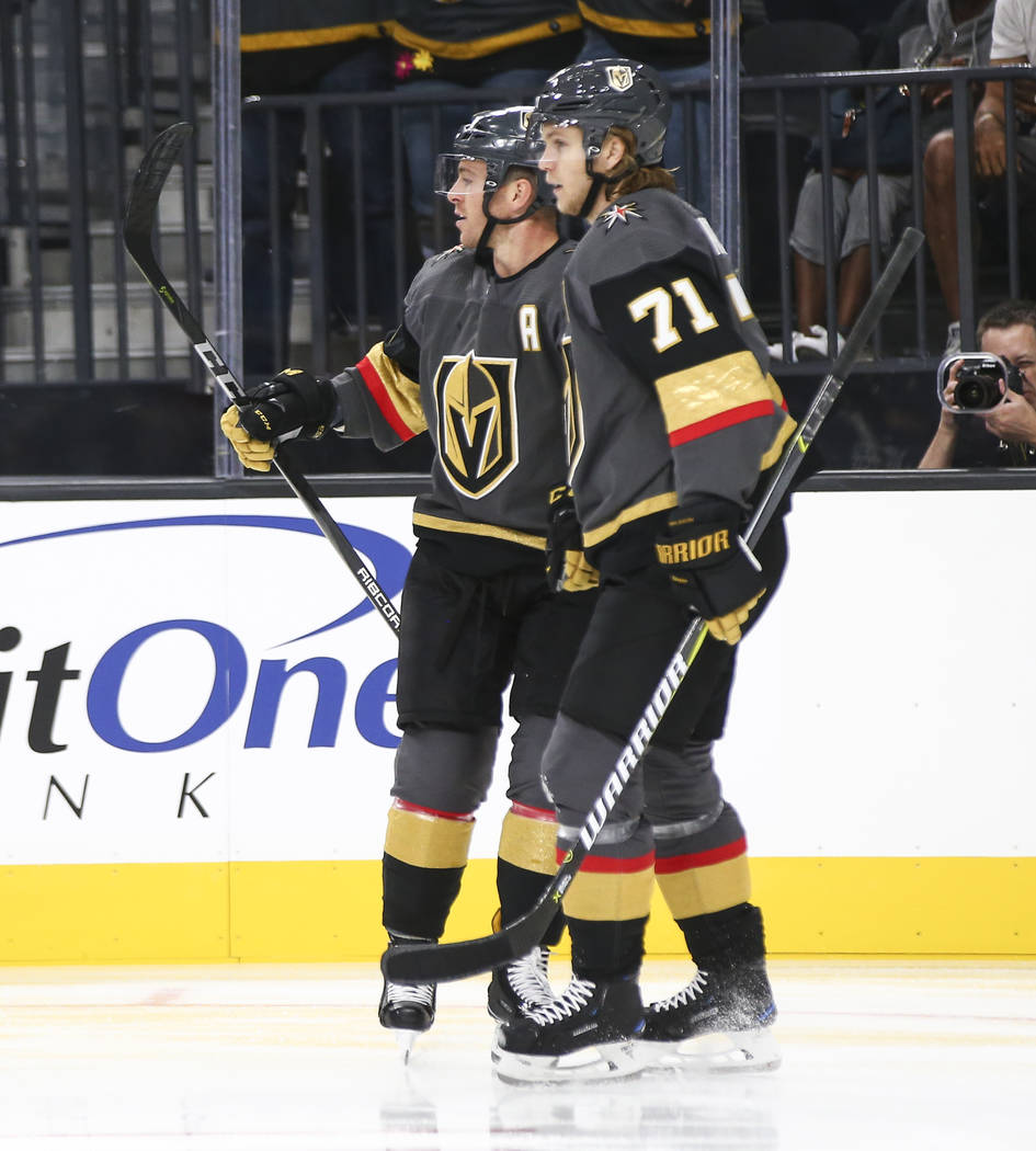 Golden Knights center Jonathan Marchessault, left, celebrates his goal with Golden Knights center William Karlsson (71) during the first period of a preseason NHL hockey game at T-Mobile Arena in ...