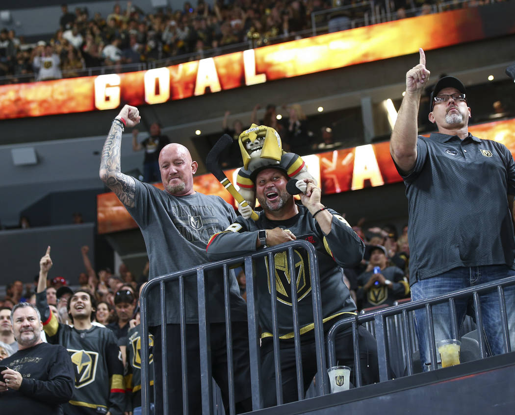 Golden Knights fans celebrate a goal by Golden Knights center Jonathan Marchessault, not pictured, during the first period of a preseason NHL hockey game against the Arizona Coyotes at T-Mobile Ar ...