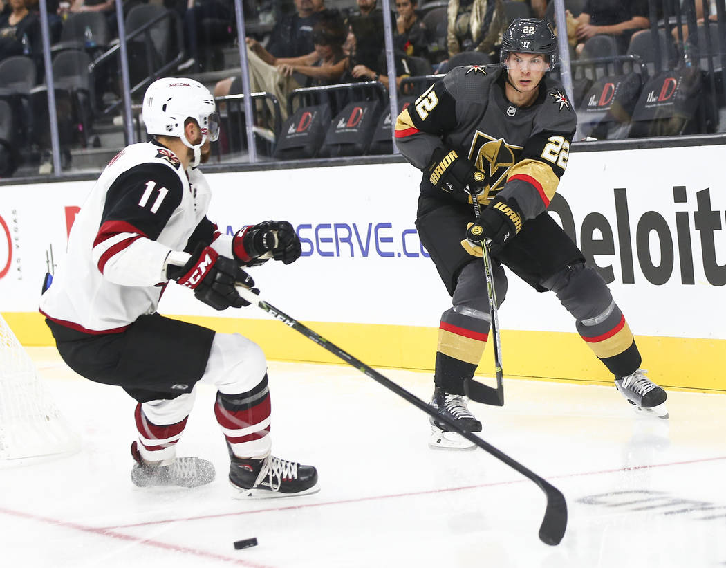 Golden Knights defenseman Nick Holden (22) sends the puck past Arizona Coyotes left wing Brendan Perlini (11) during the second period of a preseason NHL hockey game at T-Mobile Arena in Las Vegas ...