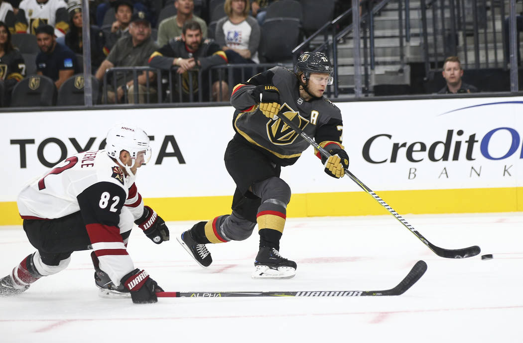 Golden Knights center William Karlsson (71) shoots past Arizona Coyotes Hudson Wilson (82) during the first period of a preseason NHL hockey game at T-Mobile Arena in Las Vegas on Sunday, Sept. 16 ...