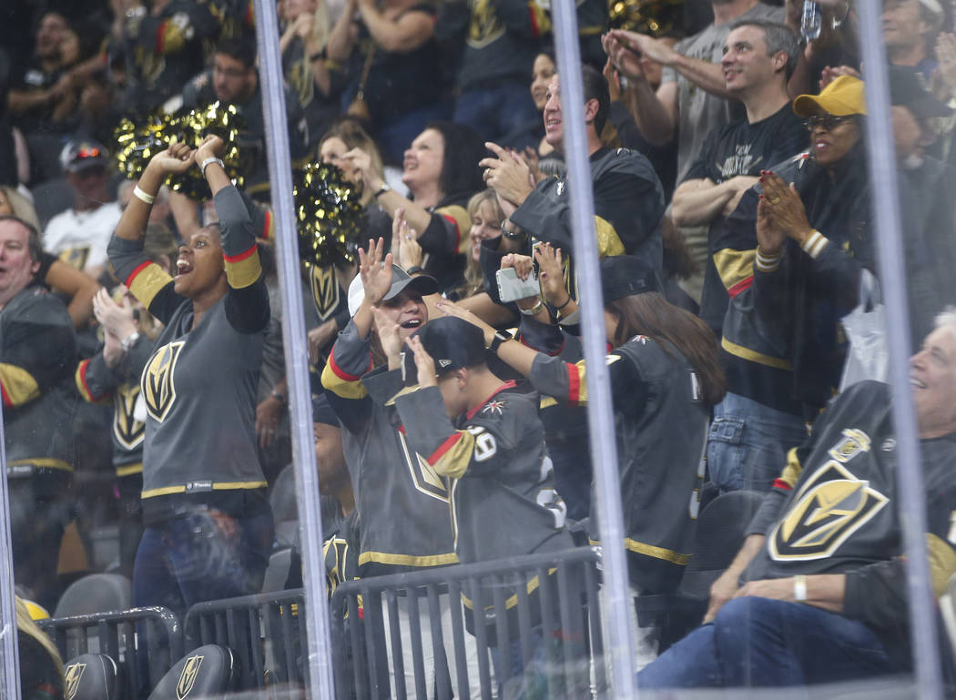 Golden Knights fans celebrate a goal by Golden Knights defenseman Nicolas Hague, not pictured, during the second period of a preseason NHL hockey game at T-Mobile Arena in Las Vegas on Sunday, Sep ...