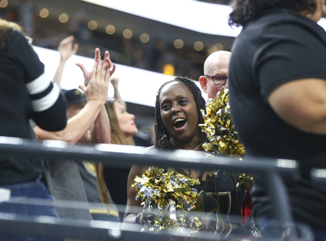 Golden Knights fans celebrate a goal by Golden Knights center William Karlsson, not pictured, during the first period of a preseason NHL hockey game at T-Mobile Arena in Las Vegas on Sunday, Sept. ...