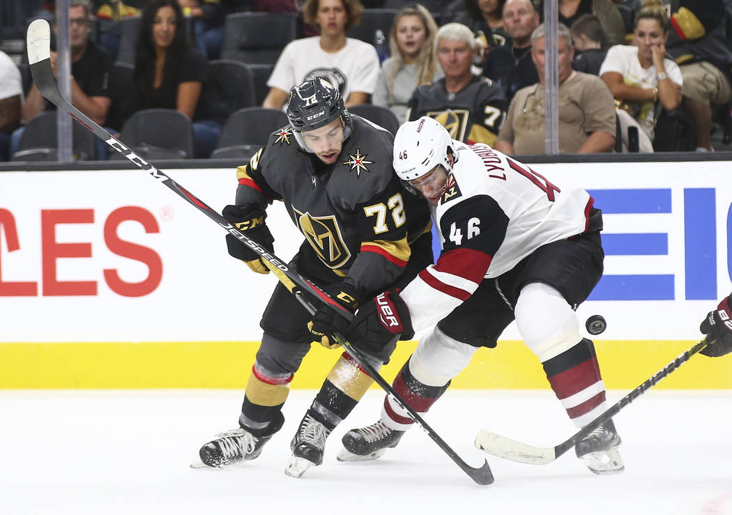 Golden Knights center Gage Quinney (72) battles Arizona Coyotes defenseman Ilya Lyubushkin (46) for the puck during the first period of a preseason NHL hockey game at T-Mobile Arena in Las Vegas o ...