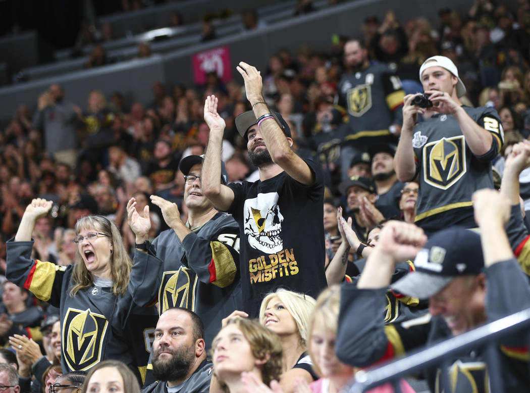 Golden Knights fans celebrate a penalty shot block by Golden Knights goaltender Dylan Ferguson, not pictured during the first period of a preseason NHL hockey game against the Arizona Coyotes at T ...