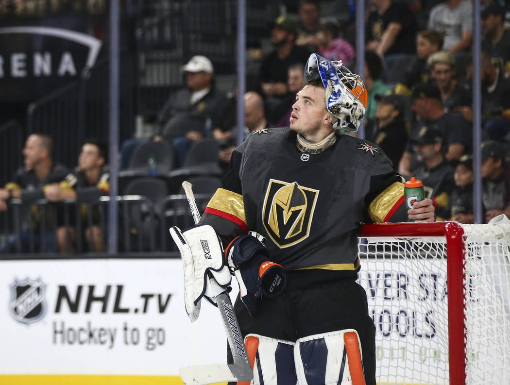 Golden Knights goaltender Dylan Ferguson (1) looks on during the second period of a preseason NHL hockey game against the Arizona Coyotes at T-Mobile Arena in Las Vegas on Sunday, Sept. 16, 2018. ...