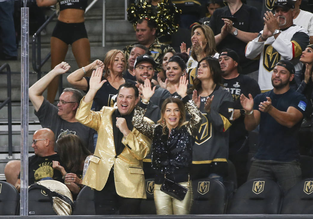 Golden Knights fans celebrate a goal by Golden Knights left wing Max Pacioretty (67) during the first period of a preseason NHL hockey game against the Arizona Coyotes at T-Mobile Arena in Las Veg ...