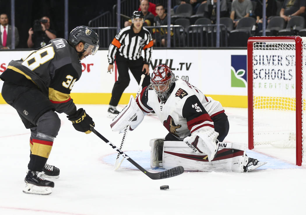 Golden Knights right wing Tomas Hyka (38) looks to shoot past Arizona Coyotes goaltender Darcy Kuemper (35) during the first period of a preseason NHL hockey game at T-Mobile Arena in Las Vegas on ...