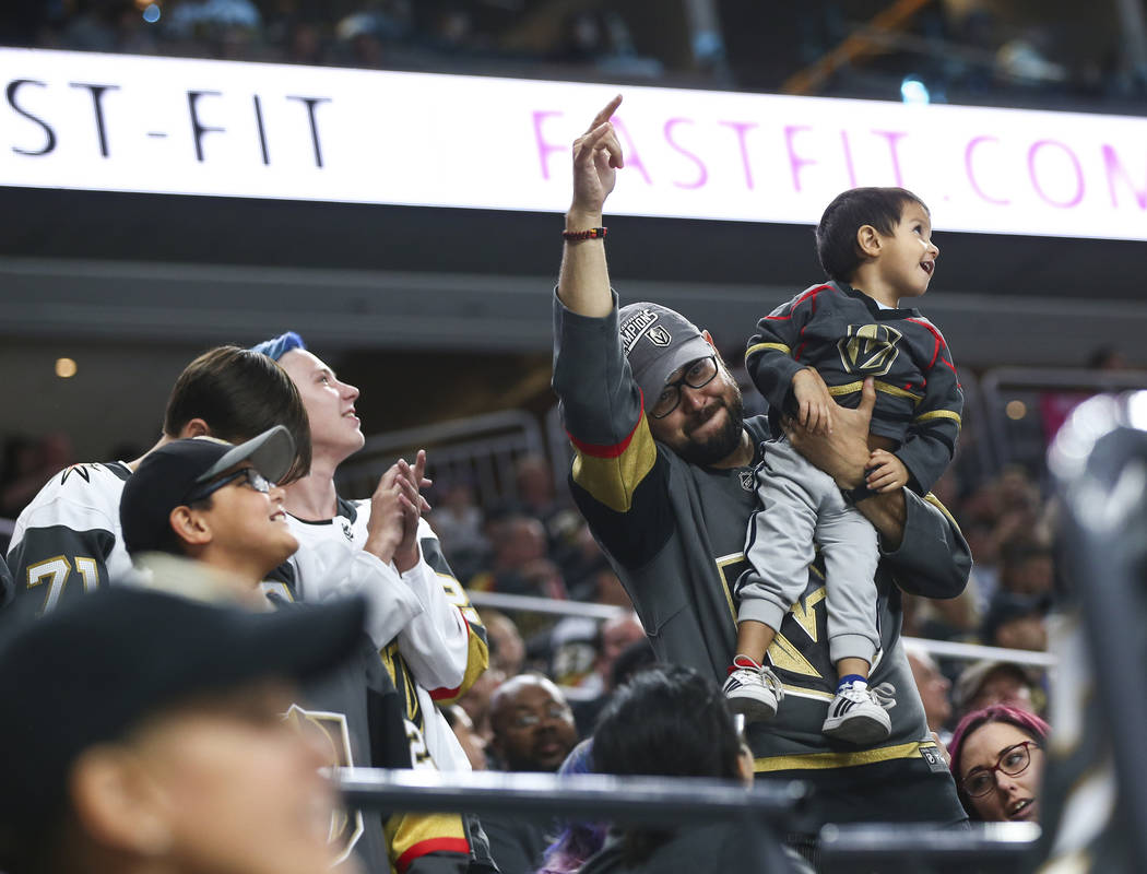 Golden Knights fans cheer during a break in the third period of a preseason NHL hockey game against the Arizona Coyotes at T-Mobile Arena in Las Vegas on Sunday, Sept. 16, 2018. Chase Stevens Las ...