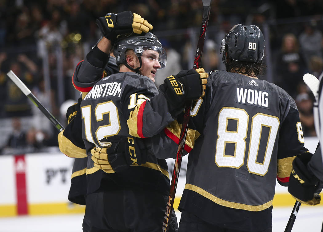 Golden Knights defenseman Erik Brannstrom (12) celebrates his goal with Tyler Wong (80) during the third period of a preseason NHL hockey game against the Arizona Coyotes at T-Mobile Arena in Las ...