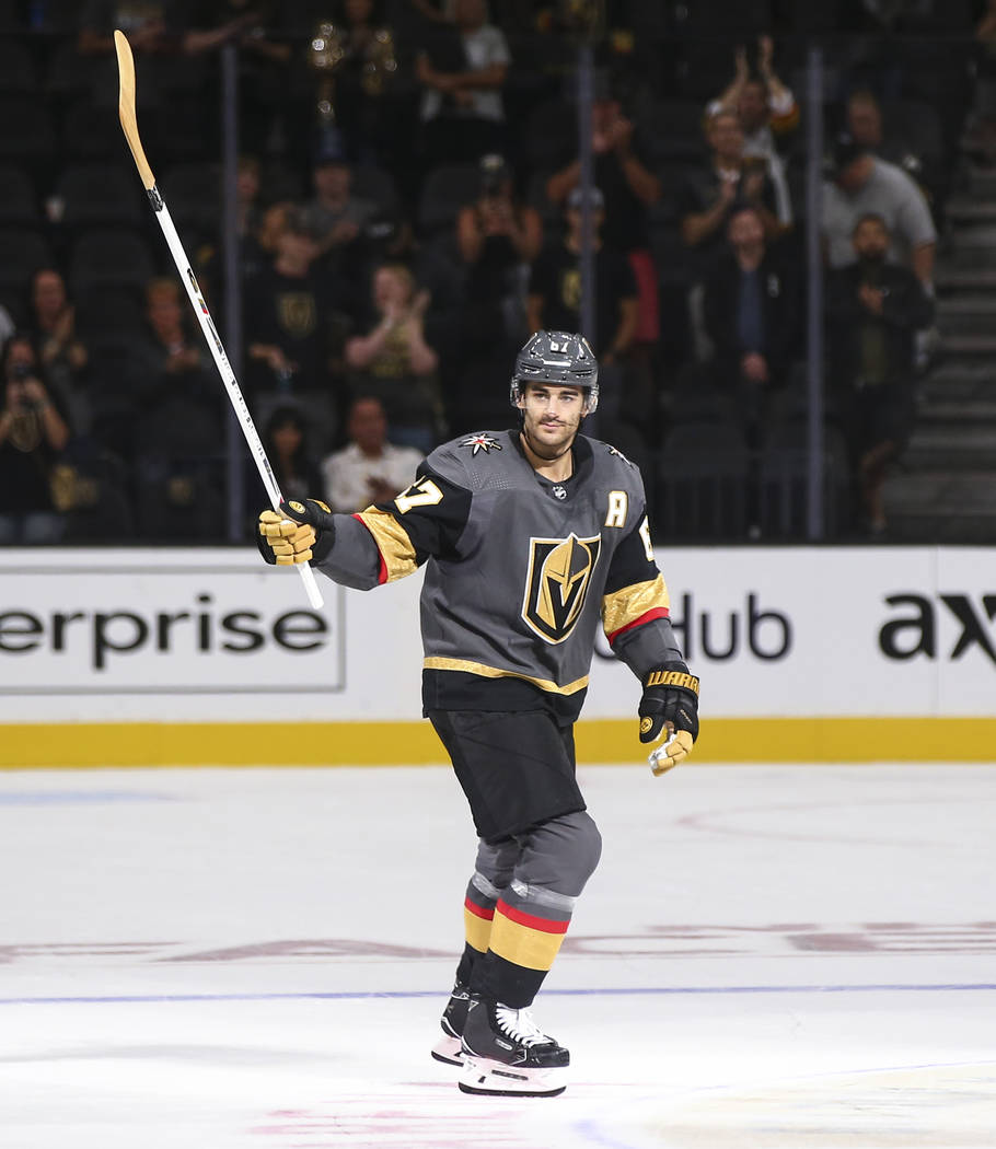 Golden Knights left wing Max Pacioretty (67) looks for a young fan to pass along a hockey stick after a preseason NHL hockey game against the Arizona Coyotes at T-Mobile Arena in Las Vegas on Sund ...