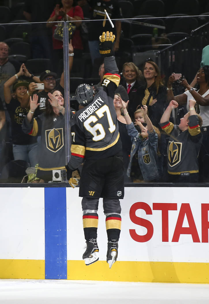 Golden Knights left wing Max Pacioretty (67) passes along a hockey stick to a young fan after a preseason NHL hockey game against the Arizona Coyotes at T-Mobile Arena in Las Vegas on Sunday, Sept ...