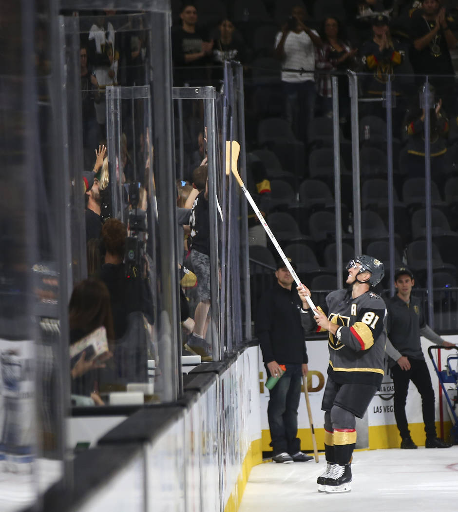 Golden Knights center Jonathan Marchessault (81) passes along a hockey stick to a young fan after a preseason NHL hockey game against the Arizona Coyotes at T-Mobile Arena in Las Vegas on Sunday, ...