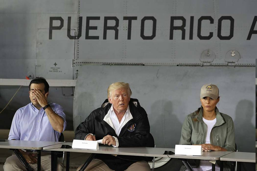 President Donald Trump talks about recovery efforts on Oct. 3, 2017, after he and first lady Melania Trump arrived at Luis Muniz Air National Guard Base to survey hurricane damage in San Juan, Pue ...