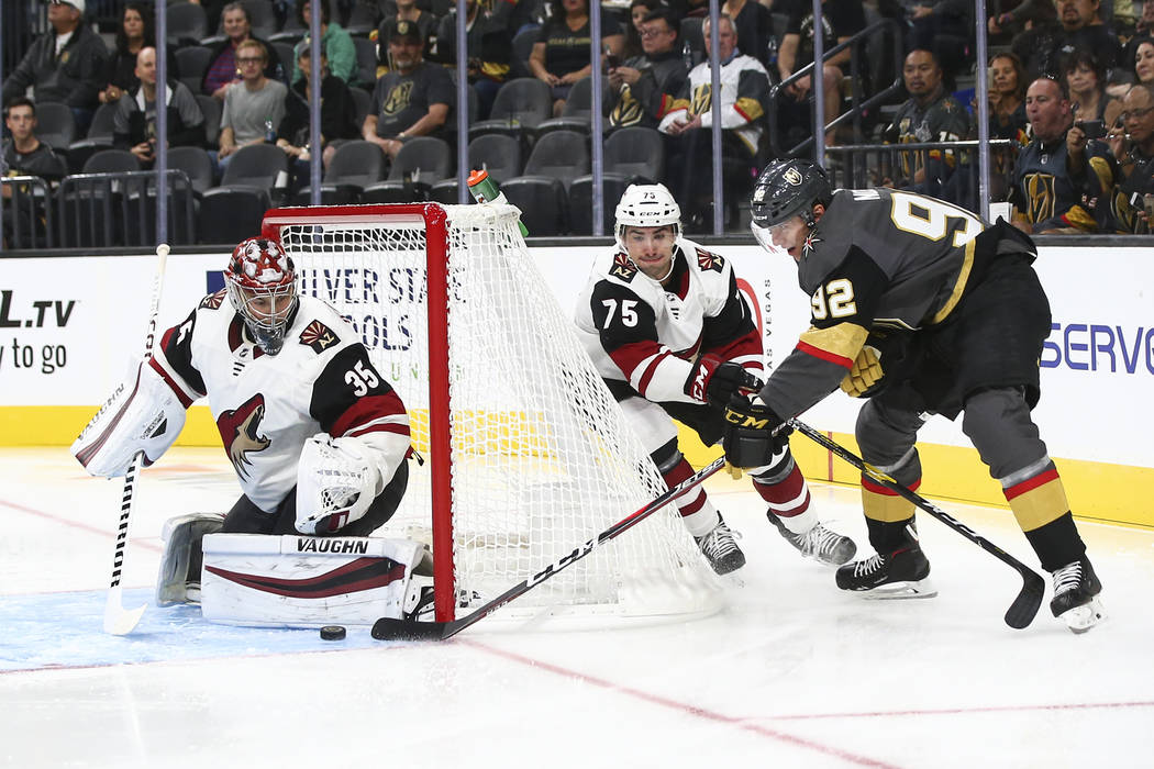 Golden Knights left wing Tomas Nosek (92) sends the puck around to assist on a goal by Golden Knights center Jonathan Marchessault, not pictured, during the first period of a preseason NHL hockey ...