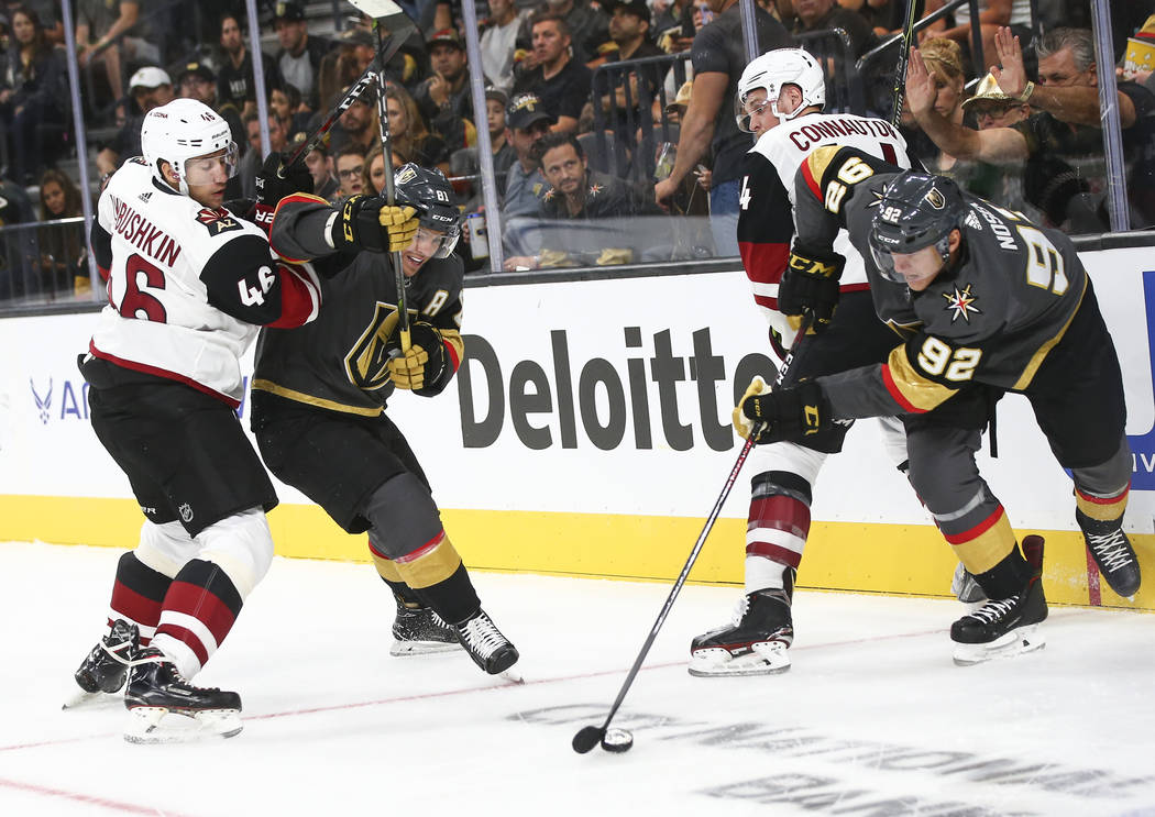 Golden Knights left wing Tomas Nosek (92) gets the puck past Arizona Coyotes defenseman Kevin Connauton (44) in front of Arizona Coyotes defenseman Ilya Lyubushkin (46) and Golden Knights center J ...