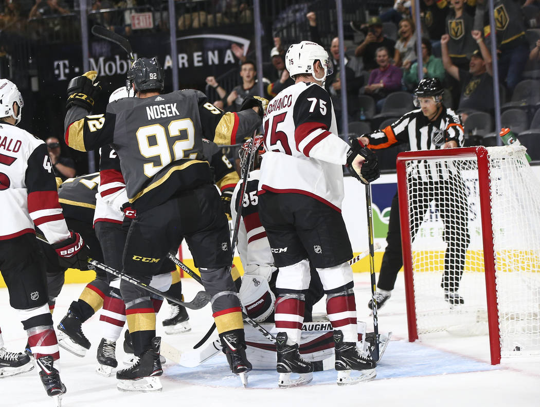Golden Knights left wing Tomas Nosek (92) celebrates a goal by Golden Knights center William Karlsson (71) against the Arizona Coyotes during the first period of a preseason NHL hockey game at T-M ...