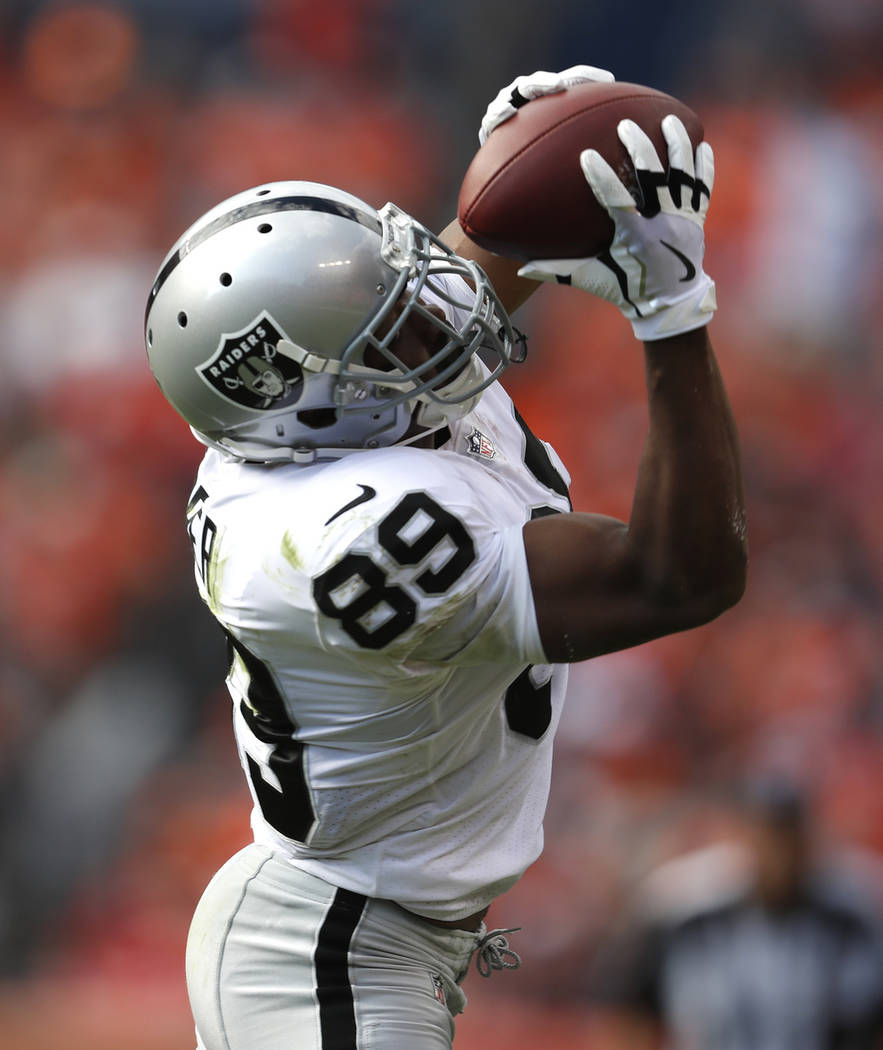 Oakland Raiders wide receiver Amari Cooper (89) catches against the Denver Broncos during the second half of an NFL football game, Sunday, Sept. 16, 2018, in Denver. (AP Photo/David Zalubowski)