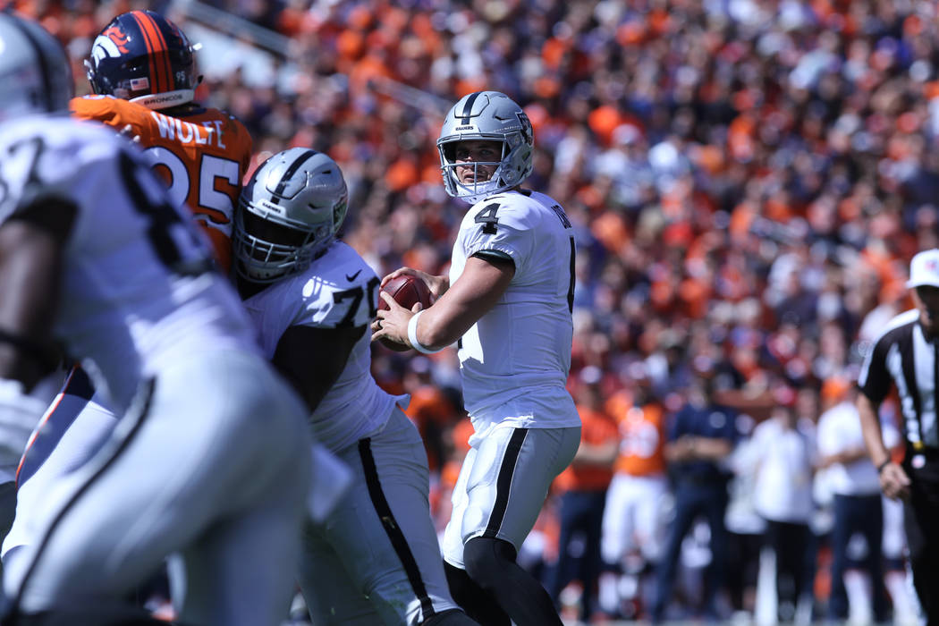 Oakland Raiders quarterback Derek Carr (4) looks to pass the football during the first half of their NFL game against the Denver Broncos in Denver, Colo., Sunday, Sept. 16, 2018. Heidi Fang Las Ve ...