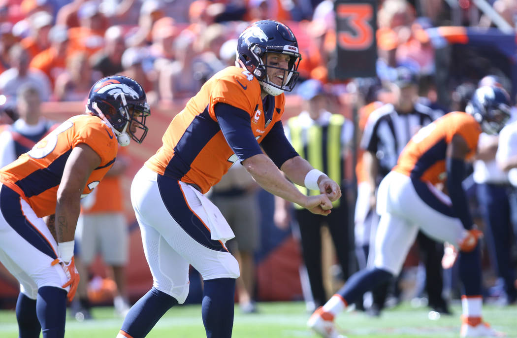 Denver Broncos quarterback Case Keenum (4) calls an audible at the line of scrimmage during the first half of their NFL game against the Oakland Raiders in Denver, Colo., Sunday, Sept. 16, 2018. H ...
