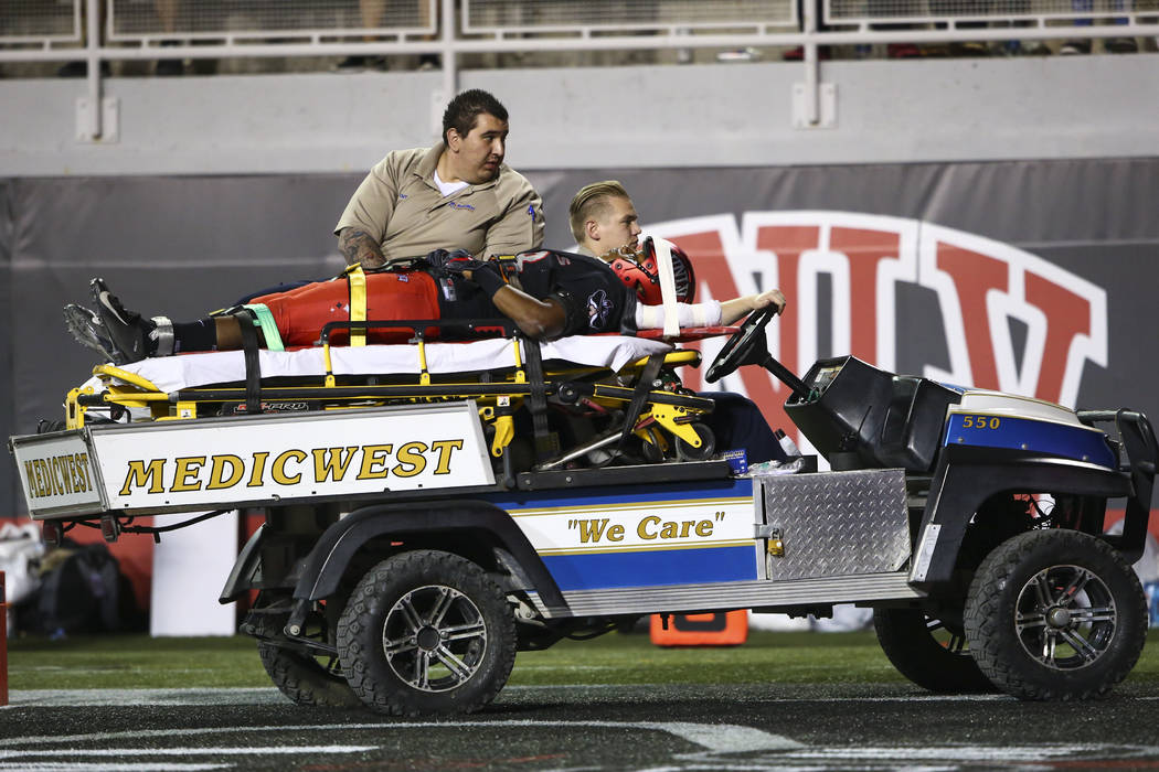UNLV Rebels defensive back Ty'Jason Roberts (38) is taken off the field by medical staff after getting injured during the first half of a football game against the Prairie View A&M Panthers at ...